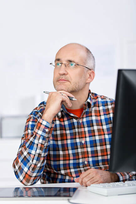 Man wondering about the services he is receiving from his current financial planner and what fees he is paying his financial advisor.